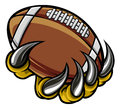 Monster Animal Claw Holding American Football Ball Stock Photos - 95492023
