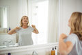 Senior Woman Stretching In Front Of The Mirror Royalty Free Stock Photos - 95501008