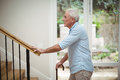 Senior Man Climbing Upstairs With Walking Stick Royalty Free Stock Photography - 95502877