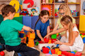 Children Building Blocks In Kindergarten. Group Kids Playing Toy Floor . Royalty Free Stock Photos - 95532328