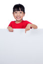 Asian Chinese Little Girl Behind A Blank White Board Stock Photo - 95557800