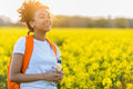 Mixed Race African American Girl Teenager In Yellow Flowers Stock Images - 95574744