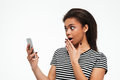 Shocked Young African Lady Chatting By Phone. Stock Image - 95623971