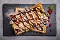 Plate Of Belgian Waffles With Chocolate Sauce And Currant Fruit Royalty Free Stock Photos - 95680248