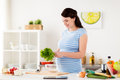 Pregnant Woman Cooking Vegetable Salad At Home Stock Photos - 95681243