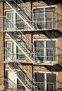 Exterior Of A Building With Old Fire Escape In  New York City Royalty Free Stock Photos - 95684608