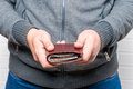 Man Holds Out His Purse With Money Stock Images - 95731904