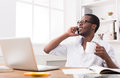 Young Black Businessman Call Mobile Phone In Modern White Office Stock Images - 95778444