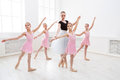 Teacher Helping Her Students During Dance Class Stock Photography - 95780792