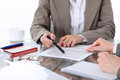Group Of Business People And Lawyers Discussing Contract Papers Sitting At The Table, Close Up Stock Photos - 95787313
