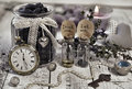 Toned Still Life With Tiny Bottles With Labels Eat Me And Drink Me, Old Clocks, Key And Honey Berry In Vintage Jar Stock Image - 95807951