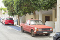 Old Rusty Red Car Parked In The Street Stock Photography - 95820172