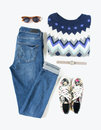 Stylish Woman Look. Woman/girl Outfit On White Background. Blue Denim Jeans , Aztek Print Sweater, Flower Print Sneakers, Retro Su Royalty Free Stock Photos - 95837608