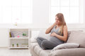 Young Vomiting Woman Sitting On Sofa Stock Photos - 95838093