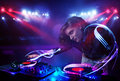 Disc Jockey Girl Playing Music With Light Beam Effects On Stage Stock Photos - 95848013