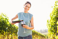 Portrait Of Smiling Woman Pouring Red Wine From Bottle In Glass Royalty Free Stock Image - 95859156