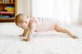 Little Funny Baby Girl Lifting Body And Learning To Crawl. Stock Photography - 95867662