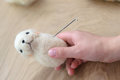 Process Of Felting A Toy From A Light Wool On A Wooden Background Royalty Free Stock Photo - 95972725