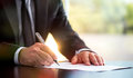 Businessman Is Signing A Legal Document Stock Image - 95995381