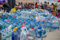 Quito, Ecuador - April,17, 2016: Unidentified Citizens Of Quito Providing Disaster Relief Water For Earthquake Survivors In The Co Stock Photography - 95997942