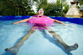 Man Swimming In A Portable Swimming Pool Royalty Free Stock Photography - 96029247