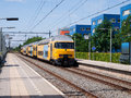 A Yellow Train Is Leaving A Station. Stock Photography - 96038342
