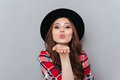 Pretty Woman In Hat And Plaid Shirt Sending Air Kiss Stock Photos - 96074323
