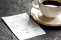 Restaurant Bill, Card And Coffee On Dark Table Background Stock Photography - 96085772