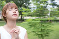 Young Woman Praying In Public Park. Asian Girl Folded Her Hands Royalty Free Stock Image - 96093776