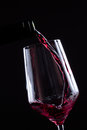 Red Wine Pouring In Wineglass From A Bottle On Black Background. Wine List Design Menu With Copyspace. Royalty Free Stock Images - 96112129