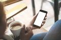 Selective Focus Woman Hand Holding Phone Sitting In Coffee Sh Royalty Free Stock Photos - 96125068