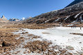 Black Mountain Witn Snow And Below With Tourists On The Ground With Brown Grass, Snow And Frozen Pond In Winter At Zero Point. Royalty Free Stock Photos - 96146508