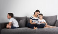 Mother Reads An Interesting Book With Her Sons. Jealousy Concept. Royalty Free Stock Photography - 96226757