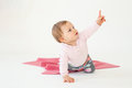 Baby Girl Sitting On Floor Isolated Over White Background Pointing Royalty Free Stock Photo - 96232375