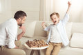 Boy Celebrating Success In Chess Game With Father Near By Royalty Free Stock Photography - 96244387