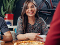 Portrait Of Young Pretty Smiling Woman Looking At Camera Sitting In Restaurant Drinking Coffee And Eating Pizza With Stock Photo - 96267080