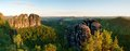 Sharp Schramsteine And Falkenstein Rocks In Panoramic View. Rocks In The Elbe Sandstone Mountains Park Royalty Free Stock Images - 96303809
