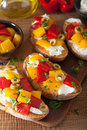 Italian Bruschetta With Roasted Peppers Goat Cheese Olives Stock Image - 96396961