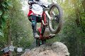 Trials Motorcycle Is Jumping Over Rocks Royalty Free Stock Photo - 96429885