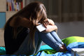 Sad Teen With A Phone In Her Bedroom Royalty Free Stock Photo - 96445635
