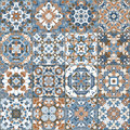 A Collection Of Ceramic Tiles In Blue And Brown Colors. Stock Photography - 96483072