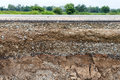 Rocky Soil Under The Eroded Road. Royalty Free Stock Image - 96490946