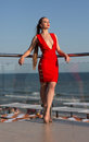 A Stunning Woman In A Red Dress On A Natural Background. A  Girl Relaxing On A Hotel Terrace. A Perfect Girl On A Summer Holiday. Royalty Free Stock Image - 96512866