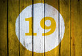 House Number Or Calendar Date In White Circle On Yellow Toned Royalty Free Stock Images - 96515549
