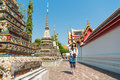 Female Tourist Girl Visiting Famous Wat Pho Temple Royalty Free Stock Photography - 96559937