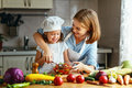 Healthy Eating. Family Mother And Child Girl Preparing Vegetaria Stock Photo - 96581760