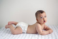 Naked Baby In Diapers Lying On Her Belly Stock Photography - 96583472