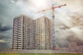 Construction Crane Builds Multi-apartment Residential House. Stock Photo - 96604480
