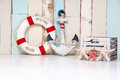 Composition On A Marine Theme With An Anchor And Life Buoy, Seashells And Starfish On A Wooden Background Royalty Free Stock Image - 96624356