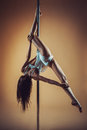Young Woman Pole Dancing Royalty Free Stock Image - 96641056